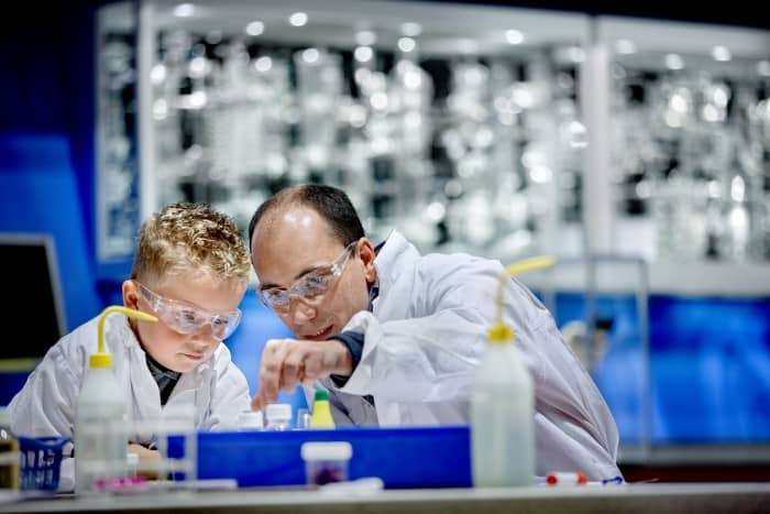 Scientist teaching a young student in a Netherlands lab